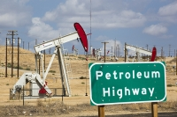 USA;US;America;California;drought;climate-change;global-warming;Kern-County;Bakersfield;drought;desicated;Kern-River-oilfield;oil;oilfield;oil-production;oil-pump;nodding-donkey;oil-well;fossil-fuel;crude-oil;raw-material;carbon;Oildale;pipe;pipeline;oil-pipe;composite;sing;road-sign;highway;petroleum;petroleum-highway