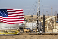 USA;US;America;California;drought;climate-change;global-warming;Kern-County;Bakersfield;drought;desicated;Midway-Sunset-oilfield;oil;oilfield;oil-production;oil-pump;nodding-donkey;oil-well;fossil-fuel;crude-oil;raw-material;carbon;wasteland;pipe;piping;oil-derrick;drilling-rig;fracking;oil-well;drilling;industry;heavy-industry;Taft;fracked;fracking;polluted;contaminated;drilling-rig;oil-worker;worker;workman;working-at-height;oil-derrick;composite;flag;red;blue;stars-and-stripes;petriot;patriotic;pride