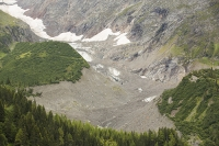 Tour-du-Mont-Blanc;Les-Houches;France;Alps;French-Alps;mountain;mountain-range;glacier;glaciation;moraine;debris;rock;terminal-moraine;lateral-moraine;erosion;shrinking;ice;cold;warming;global-warming;climate-change;glacial-retreat;water-resource;reservoir;woodland;forest;tree;pine-tree;conifer;Glacier-du-Bionnassay;Bionnassay-glacier