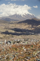 South-America;Bolivia;La-Paz;city;house;housing;dense;density;slope;hilly;Andes;altitude;high;infrastructure;overcrowded;population;building;buildings;high-rise;tower-block;city-centre;Illimani;El-Alto;mountain;altitude;high;snow;glacier;backdrop;glacial-retreat;climate-change;global-warming;mountain-range;Cordillera-Real;Altiplano