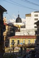 South-America;Bolivia;La-Paz;people;Illimani;El-Alto;mountain;altitude;high;snow;glacier;backdrop;glacial-retreat;climate-change;global-warming;mountain-range;Cordillera-Real;Altiplano;ciy;building;wire;telegraph-wire;electricty