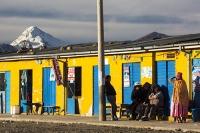 South-America;Bolivia;La-Paz;indigenous;ethnic;ethnicity;Indian;people;Huayna-Potosi;El-Alto;mountain;altitude;high;snow;glacier;backdrop;glacial-retreat;climate-change;global-warming;mountain-range;Cordillera-Real;Altiplano;man;woman;shop;yellow;peluqueria;hairdressers