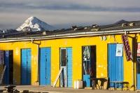 South-America;Bolivia;La-Paz;indigenous;ethnic;ethnicity;Indian;people;Huayna-Potosi;El-Alto;mountain;altitude;high;snow;glacier;backdrop;glacial-retreat;climate-change;global-warming;mountain-range;Cordillera-Real;Altiplano;shop;yellow;peluqueria;hairdressers
