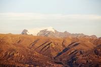 South-America;Bolivia;La-Paz;El-Alto;mountain;altitude;high;snow;glacier;backdrop;glacial-retreat;climate-change;global-warming;mountain-range;Cordillera-Real;Altiplano;sunlight;glow;sunset;erosion;badlands;eroded;steep;slope