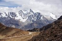 South-America;Bolivia;La-Paz;Huayna-Potosi;El-Alto;mountain;altitude;high;snow;glacier;backdrop;glacial-retreat;climate-change;global-warming;mountain-range;Cordillera-Real;Altiplano;glaciated;snowpack;melting;water-supply;track;off-road;road;car;veilce;person;moraine;lateral-moraine