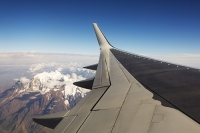 South-America;Bolivia;plane;airplane;wing;aerial;flight;aviation;mountain;Andes;Andean;snow-capped;glacier;glacial-retreat;cloud;climate-change;global-warming;altitude;high