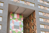 IMG_4384_pink.jpg Riverside One is a new concept in greenbuild. It adheres to the ten principles of One Planet living, Built by BioRegional Quintain in Middlesbrough, Teeside, UK. It is an exceptinal green building, whose individual housing units will have a low carbon footprint. The whole block is heated by a biofuel boiler. During construction it used recycled oil rig pipes for piling, the concrete was mixed with recycled agregate, super insulated with earth wool, it uses grey recycled water to save water, locally sourced timber, the electricity for the building is sourced from renewable sources and the buidling incorporates Swift bird boxs and bat boxs. Residents are encouraged to car share and use local organic vegetable box schemes.