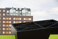 IMG_4423_Teeside.jpg Riverside One is a new concept in greenbuild. It adheres to the ten principles of One Planet living, Built by BioRegional Quintain in Middlesbrough, Teeside, UK. It is an exceptinal green building, whose individual housing units will have a low carbon footprint. The whole block is heated by a biofuel boiler. During construction it used recycled oil rig pipes for piling, the concrete was mixed with recycled agregate, super insulated with earth wool, it uses grey recycled water to save water, locally sourced timber, the electricity for the building is sourced from renewable sources and the buidling incorporates Swift bird boxs and bat boxs. Residents are encouraged to car share and use local organic vegetable box schemes.