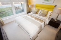 IMG_6760_bed.jpg Riverside One is a new concept in greenbuild. It adheres to the ten principles of One Planet living, Built by BioRegional Quintain in Middlesbrough, Teeside, UK. It is an exceptinal green building, whose individual housing units will have a low carbon footprint. The whole block is heated by a biofuel boiler. During construction it used recycled oil rig pipes for piling, the concrete was mixed with recycled agregate, super insulated with earth wool, it uses grey recycled water to save water, locally sourced timber, the electricity for the building is sourced from renewable sources and the buidling incorporates Swift bird boxs and bat boxs. Residents are encouraged to car share and use local organic vegetable box schemes.