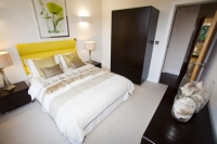 IMG_6765_bedroom.jpg Riverside One is a new concept in greenbuild. It adheres to the ten principles of One Planet living, Built by BioRegional Quintain in Middlesbrough, Teeside, UK. It is an exceptinal green building, whose individual housing units will have a low carbon footprint. The whole block is heated by a biofuel boiler. During construction it used recycled oil rig pipes for piling, the concrete was mixed with recycled agregate, super insulated with earth wool, it uses grey recycled water to save water, locally sourced timber, the electricity for the building is sourced from renewable sources and the buidling incorporates Swift bird boxs and bat boxs. Residents are encouraged to car share and use local organic vegetable box schemes.