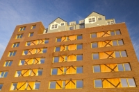 IMG_6800_wood.jpg Riverside One is a new concept in greenbuild. It adheres to the ten principles of One Planet living, Built by BioRegional Quintain in Middlesbrough, Teeside, UK. It is an exceptinal green building, whose individual housing units will have a low carbon footprint. The whole block is heated by a biofuel boiler. During construction it used recycled oil rig pipes for piling, the concrete was mixed with recycled agregate, super insulated with earth wool, it uses grey recycled water to save water, locally sourced timber, the electricity for the building is sourced from renewable sources and the buidling incorporates Swift bird boxs and bat boxs. Residents are encouraged to car share and use local organic vegetable box schemes.