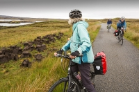 Lewis;Isle-of-Lewis;Outer-Hebrides;Hebrides;Scotland;UK;remote;peat;peat-bog;peat-cutting;fuel;energy;power;fossil-fuel;Stornoway;bike;bicycle;cycling;panniers;load;cycle-touring;road;woman;female;Pentland-road