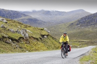 Isle-of-Harris;Outer-Hebrides;Scotland;UK;bike;bicycle;cycling;pannier;cycle-touring;road;North-Harris;route;woman;female;fit;exercise;travel;vacation;holiday;cycling;helemt;cycling-helmet;route;hilly;mountain;mountainous;pass;steep;ascent;pedalling