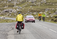 Isle-of-Harris;Outer-Hebrides;Scotland;UK;bike;bicycle;cycling;pannier;cycle-touring;road;North-Harris;route;woman;female;fit;exercise;travel;vacation;holiday;cycling;helemt;cycling-helmet;route;hilly;mountain;mountainous;pass;steep;ascent;pedalling;sheep;car;descent
