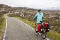 Harris;Isle-of-Harris;Outer-Hebrides;Hebrides;Scotland;UK;remote;peat;bike;bicycle;cycling;panniers;load;cycle-touring;road;woman;female;Golden-road;East-Coast;rugged;remote;barren;rocky