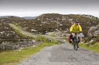 Harris;Isle-of-Harris;Outer-Hebrides;Hebrides;Scotland;UK;remote;peat;bike;bicycle;cycling;panniers;load;cycle-touring;road;woman;female;Golden-road;East-Coast;rugged;remote;barren;rocky;pannier;load