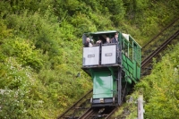 IMG_0699_water powered.jpg The cliff railway linking Lynmouth with Lynton on the north Devon coast. The railway is water powered, with a tank underneath the top carriage filling with water, till it is heavy enough to fall by gravity, pulling the lower carriage up the hill.