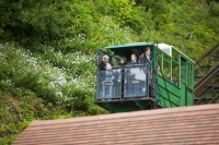 IMG_0704_cliff railway.jpg The cliff railway linking Lynmouth with Lynton on the north Devon coast. The railway is water powered, with a tank underneath the top carriage filling with water, till it is heavy enough to fall by gravity, pulling the lower carriage up the hill.