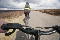 IMG_2185_cyclist.jpg A woman mountain biking over the North York Moors road from Hutton-le-Hole to Rosedale.