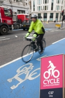 IMG_8681_blue.jpg A cyclist on one of the new Cycle Superhighways, in this case the CS7 that goes from Southwark bridge to Tooting. It makes cycling much safer and encourages moe people to take their journey by bike, reducing congestion and the greenhouse gas emissions from other typs of transport.
