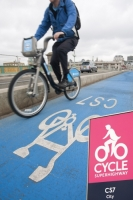 IMG_8706_pink.jpg A cyclist on one of the new Cycle Superhighways, in this case the CS7 that goes from Southwark bridge to Tooting. It makes cycling much safer and encourages moe people to take their journey by bike, reducing congestion and the greenhouse gas emissions from other typs of transport.