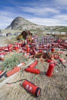 Greenland;Kangelussuaq;metal;steel;refuse;garbage;abandoned;shell;colour;colourful;rubbish;dump;red;bright;cylinder;gas-cylinder;gas;Halon;halon-gas;danger;dangerous;pollution;polluted;contaminated;contamination;fire-extinguisher;extinguisher;agent
