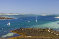 Cornwall;UK;coastal;sea;atlantic;ocean;sky;blue;outdoors;landscape;summer;sun;Tresco;island;Scilly;Scilly-Isles;Isles-of-Scilly;Gulf-Stream;mild;tropical;North-Atlantic-Drift;sea-temperature;ocean-current;vegetation;climate-change;global-warming;tropical;beach;sand;sandy;tide;low-tide;intertidal;aquamarine;shallow;sea-bed;yacht;sailing-boat;boat;moored;path;footpath;sea-weed