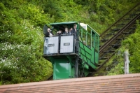 IMG_0702_cliff railway.jpg The cliff railway linking Lynmouth with Lynton on the north Devon coast. The railway is water powered, with a tank underneath the top carriage filling with water, till it is heavy enough to fall by gravity, pulling the lower carriage up the hill.