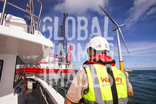 A health and safety inspector on a crew transfer vessel at the Walney offshore wind farm, Cumbria, UK.