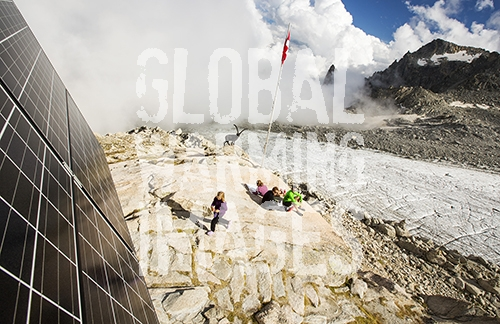 Solar panels on the Cabanne D' Orny in the Swiss Alps, providing electricity for this off grid mountain hut at over 10,000 feet. In the background is the D'Orny glacier which is receding rapidly.
