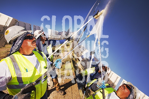 Workers washing the heliostats to maximise reflective power at the Ivanpah Solar Thermal Power Plant.