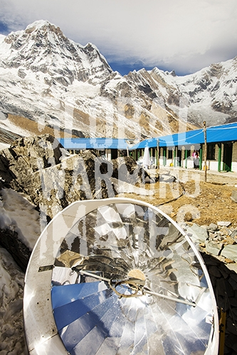 A solar cooker for baking bread at Annapurna Base Camp, Himalayas, Nepal.