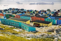 Ilulissat;Greenland;arctic;Inuit;colour;colourful;ice;iceberg;floating;sea;coast;Kangia;Ilulissat-glacier;Sermeq-Kujalleq;eskimo;house;housing;rock;sea;coast;climate-change;global-warming;Arctic;arctic-circle;accomodation;wood;wooden;insulated;Jacobshavn-glacier;Jacobshavn;town;village;community;light;midnight;midnight-sun;summer;iceberg;harbour;boat;icefjord;grounded;sea-ice;spectacle;location;spectacular;amazing;tourist-attraction;visitor-attraction;wonder;UNESCO;world-heritage-site;heritage