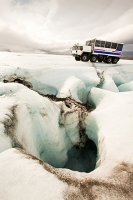 Iceland;melting;summer;glacier;glaciation;ice;ice-cap;Langjokull;glacial-retreat;retreating;recede;receding;climate-change;global-warming;truck;vehicle;tourism;tourist-attraction;wheel;specialist;ice-travel;glacier-travel;lorry;meltwater;water;melting;moulin;sink;crevasse;crevassed