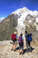 Tour-du-Mont-Blanc;Italy;Alps;Italian-Alps;mountain;mountain-range;weather;rocks;slope;geology;walking;trek;Tour-du-Mont-Blanc;footpath;long-distance-footpath;outdoors;path;sunlight;mountain-walking;Lex-Blanche;Vallon-de-la-Lex-Blanche;route;TMB;Val-Veny;man;woman;walking;walking-group;trek;trekking;trekking-poles;wallking-poles;fitness;ascend