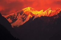 Himalaya;Himalayas;Nepal;Annapurna;peak;mountain;mountains;summit;winter;ice;ice-snow;glacier;glacial;Annapurna-Sanctuary;rock;cliff;steep;cliff-face;white;wind;windy;summit;snow;sunset;dusk;glow;light;warm;colour;pink;afterglow;alpenglow;Annapurna-Sanctuary;Machapuchare;Fish-Tail;Fiah-Tail-Peak