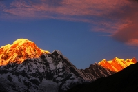 Himalaya;Himalayas;Nepal;Annapurna;peak;mountain;mountains;summit;winter;ice;ice-snow;glacier;glacial;Annapurna-Sanctuary;rock;cliff;steep;cliff-face;white;wind;windy;summit;snow;sunset;dusk;glow;light;warm;colour;pink;afterglow;alpenglow;Annapurna-South