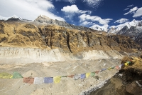 Himalaya;Himalayas;Nepal;Annapurna;peak;mountain;mountains;summit;FishTail;Machapuchare;sacred;winter;ice;ice-snow;glacier;glacial;glacial-retreat;climate-change;global-warming;Annapurna-Sanctuary;rock;cliff;steep;ravine;gully;cliff-face;white;warming;moraine;lateral-moraine;debris;water;water-supply;reservoir;Asia;retreat;retreating;recede;receding;South-Annapurna-glacier;gully;cavern;valley;u-shaped;geography;geomorphology;hole;South-Annapurna-Glacier;trekkers;trek;prayer-flag;bunting;religion