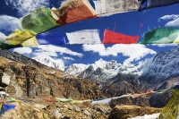 Himalaya;Himalayas;Nepal;Annapurna;peak;mountain;mountains;summit;Annapurna-South;sacred;winter;ice;ice-snow;glacier;glacial;Annapurna-Sanctuary;rock;cliff;steep;cliff-face;white;summit;snow;ABC;trek;trekker;Annapurna-Base-Camp;altitude;height;trekking;prayer-flag;prayer-flags;colourful;shrine;holy;sacred;Machapuchare;Fish-Tail-peak;sky;blue;cloud;colourful;colorful