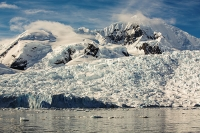 Austral;South-Atlantic;Antarctic;Antarctic-Peninsular;southern-Ocean;Southern;climate-change;global-warming;sunlight;Antarctica;rock;rocky;cliff;sea-cliff;iceberg;landscape;ice;sea-ice;ice-sheet;glacier;glacial-retreat;white;mountain;ridge;rugged;remote;vista;view-point;view;stunning;awesome;landscape;sheltered;iceberg;sea-ice;weather;cloud;sky;calm;bay;Paradise-Bay;Graham-Land;Paradise-Harbour;pristine;wilderness;reflection;bergy-bits;brash-ice;sea-ice-retreat;Mount-Walker;glacier;snow