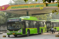 Delhi;India;Asia;transport;green-transport;infrastructure;CNG;compressed-natural-gas;bus;public-transport;Delhi-transport-Corporation;eco;green;environment;worlds-largest;fleet;emissions;clean;air-quality;exhaust;man;mlae;driver;bus-driver;gas-station;filling-up;fuel