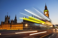 Thames;Westminster;London;UK;architecture;glow;evening;dusk;light;sunset;sky;silhouette;Houses-of-Parliament;Big-Ben;parliament;democracy;icon;iconic;embankment;bus;public-transport;headlights;motion;movement;zoom;blur;travel;Westminster-Bridge;road;traffic