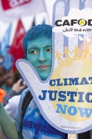 London;UK;street;protest;protestor;protesting;demonstration;demonstrating;climate-change;global-warming;crowd;mass;rally;The-Wave;Wave;Stop-Climate-Change-Coalition;march;movement;mass-movement;political-movement;CO2;emissions;environment;climate;voice;banner;blue;planet;Copenhagen;message;Houses-of-Parliament;voice;climate-chaos;man;face;makeup;blue;chant;hand;climate-justice;justice