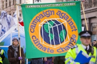 London;UK;enviroment;climate-change;global-warming;science;protest;protestor;protesting;march;action;direct-action;publicity;cause;highlight;publicity;poster;banner;flag;point-of-view;climate-criminal;carbon-footprint;C02;carbon-dioxide;carbon-emmisions;organisation;movement;change;pressure;affirmitive-action;rally;green;environmental-movement;campaign;placard;costume;dressed-up;making-point;messenger;coal;no-coal;Kingsnorth;coal-fired-power-station;fossil-fuel;greenhouse-affect;greenhouse;planet;earth;globe;world;police;policing