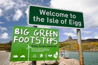 Eigg;island;Scotland;UK;Eigg-Heritage-Trust;community;energy;power;electric;electricity;renewable;renewable-energy;renewable-power;wind-power;solar-power;hydro;hydro-power;clean;green;zero-emissions;climate-change;global-warming;carbon-footprint;feed-in-tariff;future;Eigg-electric;self-sufficient;self-sufficiency;sign;welcome;big;green;footsteps;statement;pride;lifestyle;environment;eco;peak;An-Sgurr;promontary;prow;icon