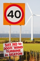 Seaton;Workington;Cumbria;UK;protest;protest-sign;road;roadside;road-sign;energy;power;energy-coast;West-coast;renewable;renewable-energy;wind;wind-power;wind-turbine;wind-farm;offshore;offshore-wind-farm;Robin-Rigg;turbine;green;clean;carbon-neutral;climate-change;global-warming;no;red;40;forty;speed-limit;speed;speed-restriction;forty-mile-and-hour