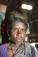 Karnataka;Mysore;India;solar;solar-power;solar-panel;solar-energy;climate-change;global-warming;solar-PV;carbon-neutral;clean;green;solar-cell;PV;photo-voltaic;light;woman;female;old;old-man;middle-aged;renewable;renewable-energy;poor;poverty;house;hut;mud-hut;caste;caste-system;Untouchable;Untouchables;discrimination;human-rights;charity;underclass;progress;energy;power;electricity;empower;empowerment;Hindu;religion;lighting;illumination;poor;poverty