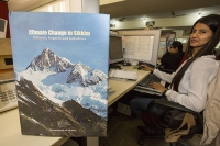 India;Asia;climate-change;global-warming;book;report;science;scientist;Sikkim;mountain;Himalayas;glacier;glacial-retreat;patterns;impacts;initiatives;desk;worker;woman;female;WWF