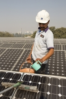 Delhi;India;Asia;investment;investing;growth;Tiger-economy;infrastructure;climate-change;global-warming;energy;power;electricity;Solar;Solar-power;solar-energy;solar-panel;PV;photo-voltaic;generation;generating;green;clean;carbon-footprint;carbon-neutral;1MW;mega-watt;Tata;Tata-Power;renewable;renewable-energy;renewable-power;worker;green-job;green-jobs;wash;washing;dust;dusty;efficiency;water;water-use