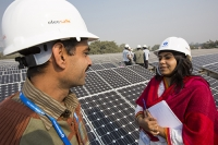 Delhi;India;Asia;investment;investing;growth;Tiger-economy;infrastructure;climate-change;global-warming;energy;power;electricity;Solar;Solar-power;solar-energy;solar-panel;PV;photo-voltaic;generation;generating;green;clean;carbon-footprint;carbon-neutral;1MW;mega-watt;Tata;Tata-Power;renewable;renewable-energy;renewable-power;worker;green-job;green-jobs;man;male;woman;female;PPE;helmet;hard-hat;protection;health-and-safety